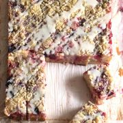 Blackberry Rhubarb Dream BarRecipe. Made with cheesecake filling, and a crumble top drizzled with icing for good measure. Perfect for a picnic or a casual brunch!