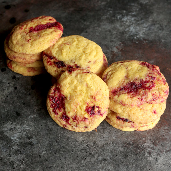 Soft and chewy Lemon Raspberry Cookies sandwiched with vanilla ice cream. These cookies are summer time in a bite! Get the recipe and wow your party guests!