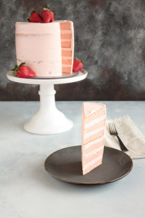 The most decadent Pink Champagne cake recipe ever. Based on Kara's Perfect Vanilla Cake and paired with a REAL strawberry Swiss Buttercream. Try this recipe now!