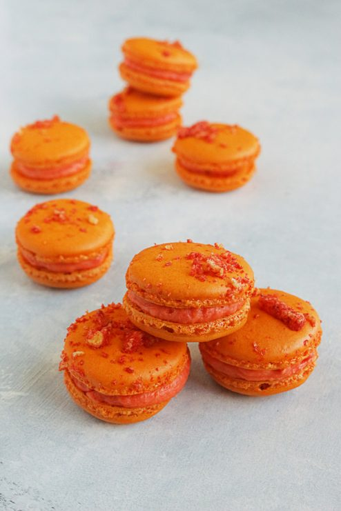 The most ridiculous macaron to have been made yet... This is what happens when the Flamin' Hot Cheeto has a delicious love child with the classic French Macaron. And the dessert world will never be the same.